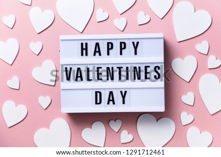 Happy Valentin's Day lightbox message with white hearts on a pink background