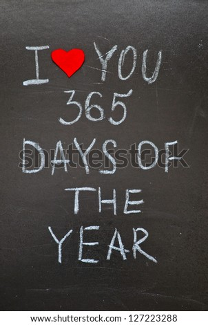 """Happy Valentine's Day, inscription chalk on a board by hand """" I love 365 days of the year"""" - stock photo"""