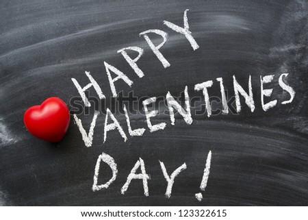 happy valentine's day phrase handwritten on blackboard