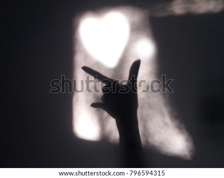 Happy Valentine's Day, pure white heart and shiny hands, a symbol of love. #796594315