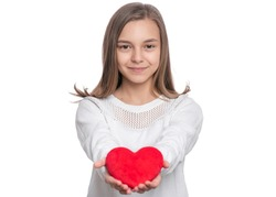 Happy Valentines Day. Cute young Teen Girl in Love with Red plush Heart in her hands. Smiling Child looking at camera, isolated on white background.
