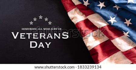 Happy Veterans Day concept. Vintage American flags against blackboard  background. November 11.