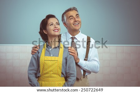 Happy vintage couple at home posing and smiling at camera