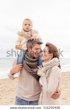 happy walking family enjoying season