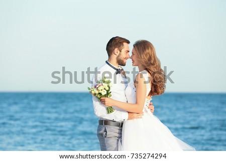 Happy wedding couple on sea beach Сток-фото ©