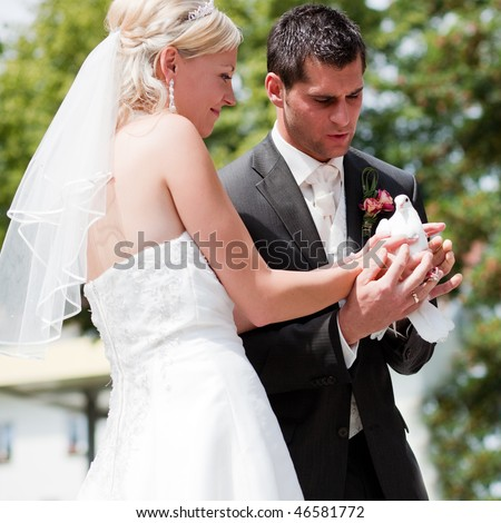 stock photo Happy wedding couple they are holding doves in their hands
