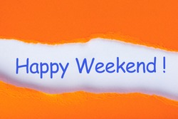 Happy Weekend - Hand writing text on a piece of paper on orange torn envelope background