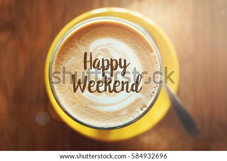 HAPPY WEEKEND word on a cup of hot coffee