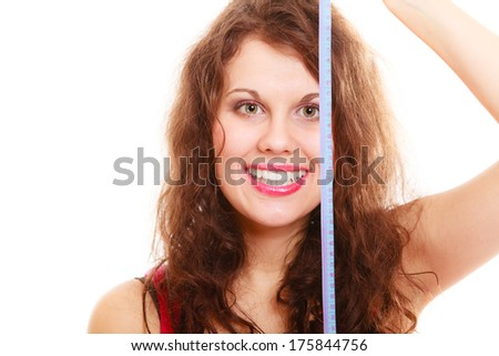 Happy weight loss young sport fitness woman girl with measure tape isolated. Diet. Studio shot.