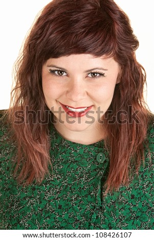 Happy white female in green dress smiling