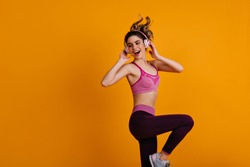 Happy white girl enjoying zumba. Indoor photo of dancing fitness woman.