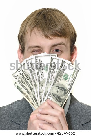 Happy winking businessman holding money isolated on white