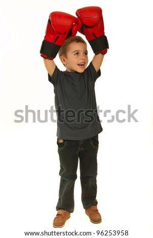 Happy winner boxer kid raising arms in boxing gloves and looking away isolated on white background