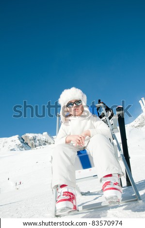 Happy winter vacation - little skier in ski resort (copy space, cover )