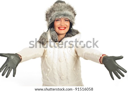Happy winter woman opening hands to you isolated on white background