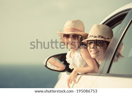 happy woman and child in car...