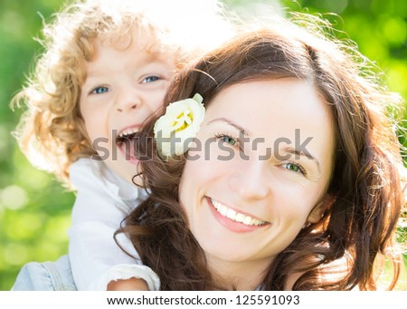 Happy woman and child in spring park
