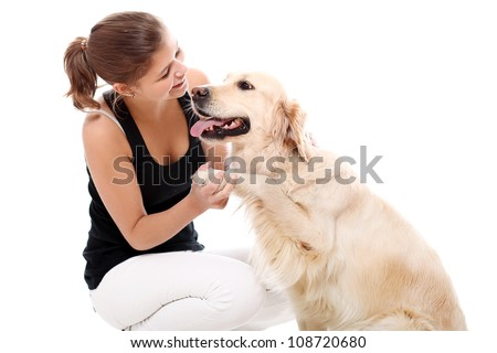 Happy woman and her beautiful dog over white background
