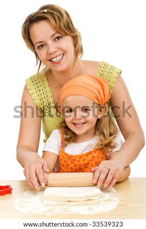 Happy woman and little girl stretching the dough together - isolated