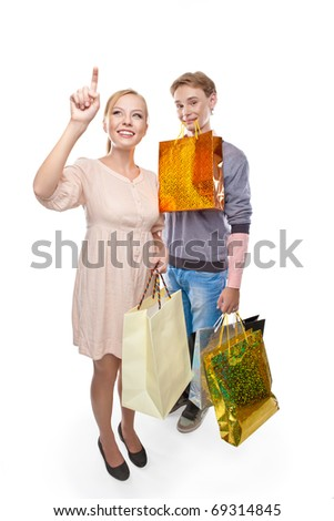 Happy woman and  man is holding paper bags over white background