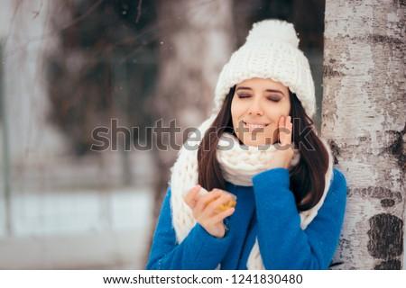 Happy Woman Applying Skin Moisturizing Cream Outdoors in Winter. Cautious girl using anti aging sunscreen in wintertime