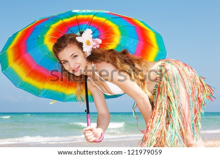 Happy woman at the beach enjoying vacation
