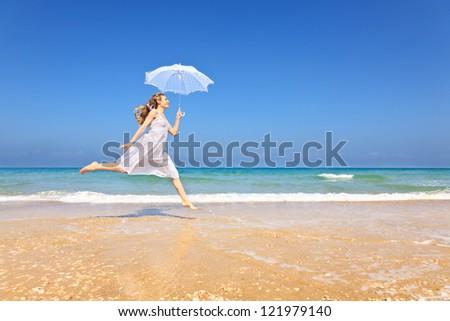 Happy woman at the beach enjoying vacation