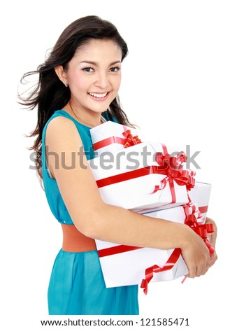happy woman carrying gift box isolated over white background