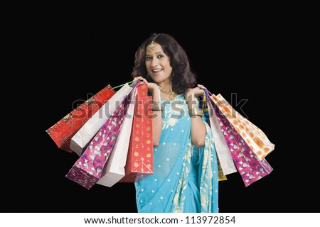 Happy woman carrying shopping bags