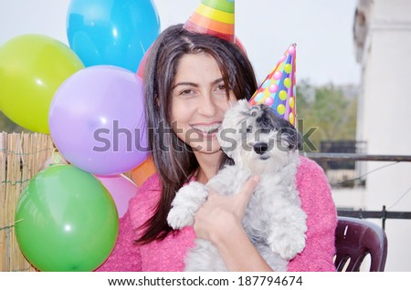 happy woman celebrating her birthday with her dog