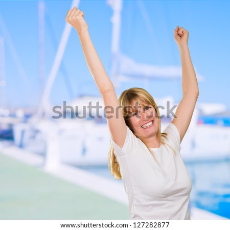 Happy Woman Cheering at a port full of boats