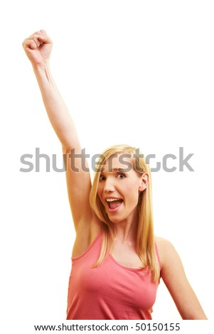 Happy woman cheering with her clenched fist