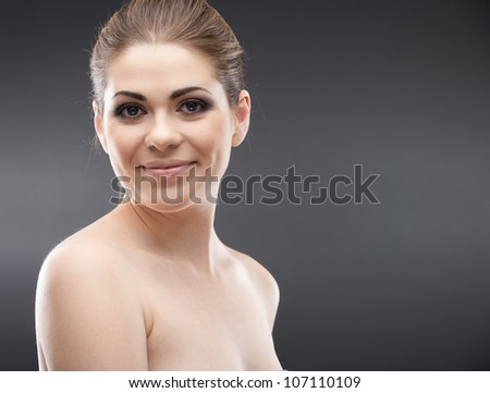 Happy woman close up face portrait isolated on gray background