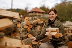 Happy woman collecting fire wood.