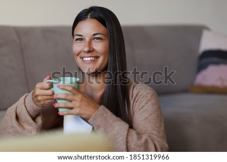 Happy woman day dreaming during coffee time at home. Photo stock ©