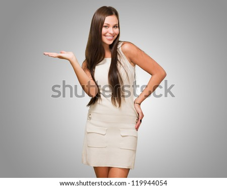 Happy Woman doing a gesture against a grey background