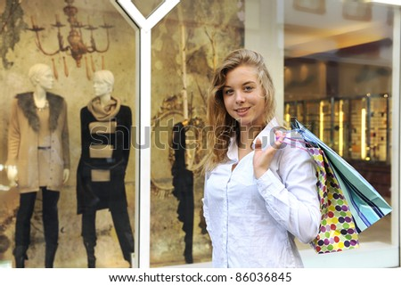 happy woman doing shopping smiling - stock photo