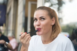 Happy woman eat with fork in restaurant in paris, france. Hunger, appetite concept. Food, snack, eating.