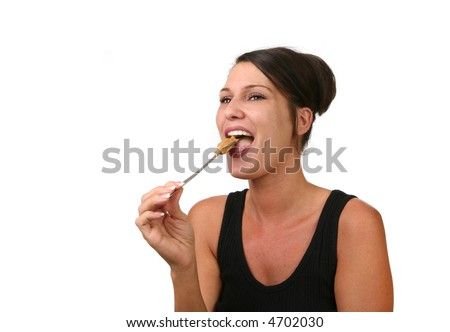 Happy Woman Eating Peanut Butter on a Spoon