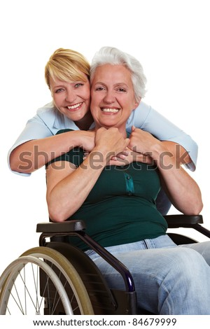 Happy woman embracing disabled senior woman in wheelchair