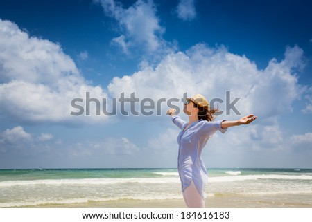 Happy woman enjoying at the beach. Summer vacations concept #184616183