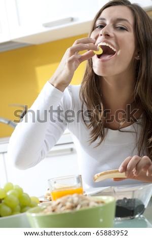 Happy woman enjoying her healthy breakfast