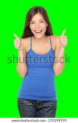 Happy woman giving thumbs up success hand sign smiling joyful and happy. Pretty young multiracial Asian / Caucasian female model in tank top. Isolated on green screen chroma key background. stock photo