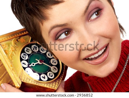 Happy woman hearing an old clock. Over white background