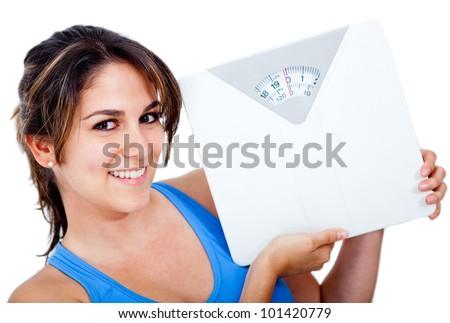 Happy woman holding a scale - weight loss concepts - stock photo