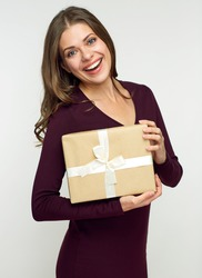 Happy woman holding gift box. Isolated portrait on white.