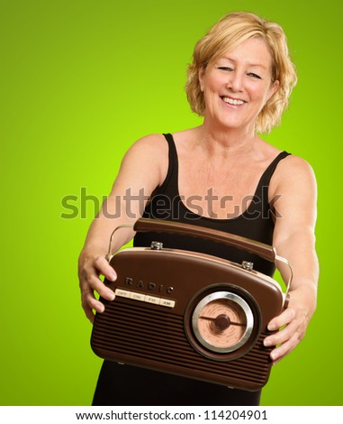 Happy Woman Holding Old Radio Isolated On Green Background
