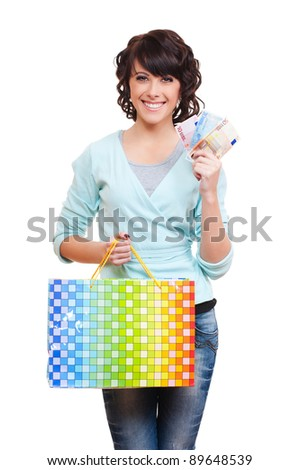 happy woman holding paper bag and money. isolated on white background