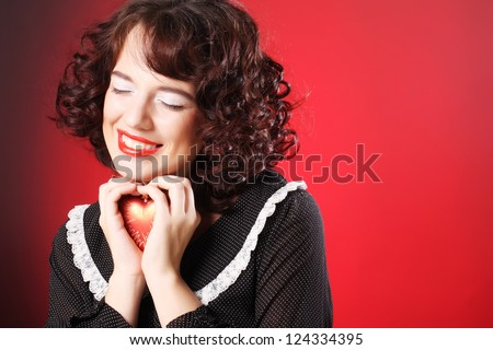 happy woman holding red heart. Valentine theme.