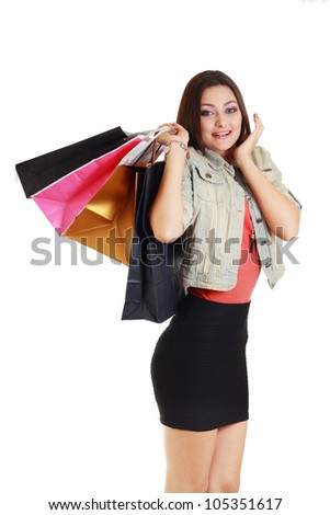 happy woman holding shopping bags isolated on white background